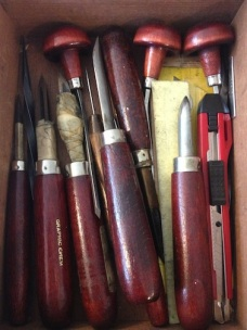 a box full of etching and engraving tools
